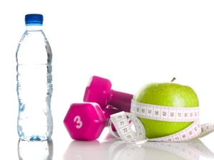 Dumbbells, apple, measure tape and bootle of water